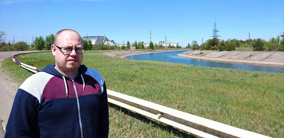 Standing with the Chernobyl Nuclear Power Plant behind me